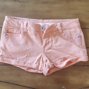Peach colored shorts with embroidered details